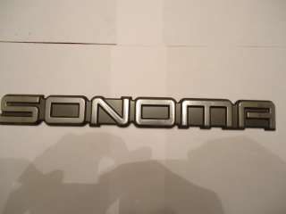1990 s ERA GMC Sonoma Rear Emblem NICE USED SHAPE